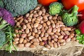 foto of pinto  - Pinto beans and vegatables on the old wooden table - JPG