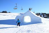 stock photo of cave woman  - woman is skiing in a snow park in the alps  - JPG