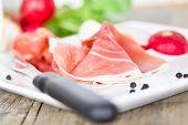 foto of smoked ham  - smoked ham on white plate close up - JPG