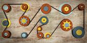foto of gear wheels  - Image of wooden wheel toy machine with gear wheels and band rope - JPG
