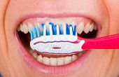 stock photo of toothbrush  - Close up photo of tooth cleaning with toothbrush - JPG
