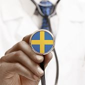 stock photo of sweden flag  - Stethoscope with national flag conceptual series  - JPG