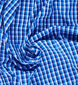 stock photo of fragmentation  - Wrinkled squared blue cloth fabric fragment as an abstract background composition - JPG