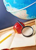 foto of geography  - Studying geography composition of the red apple - JPG