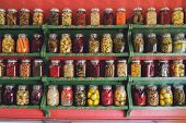 pic of pickled vegetables  - collection of glass jars with colorful pickled vegetables - JPG