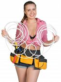 picture of coil  - Woman in tool belt holding coils of cable - JPG