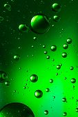 foto of vivid  - Vivid green oil and water abstract - JPG