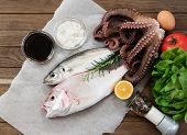 picture of sucker-fish  - Fresh fish and vegetables on wooden table - JPG