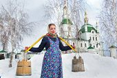 stock photo of yoke  - Russian beauty comes with a yoke for water