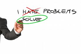 stock photo of hate  - Businessman deciding to face problems and solve them instead of hating them - JPG