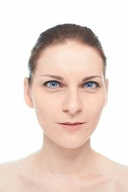 picture of sarcastic  - Young caucasian woman portrait with a sarcastic or bemused facial expression - JPG