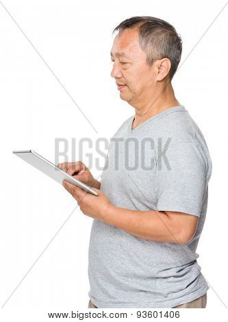 Asian old man use of digital tablet