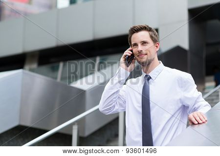 Young businessman talk to cellphone at outdoor