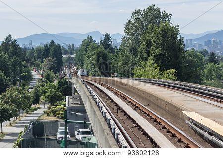 Passenger Train Moving on Tracks