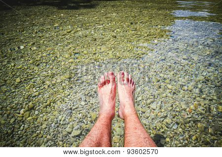 feet in summer by the water of a river in an inland lake