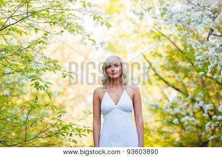 young woman walking in the spring garden