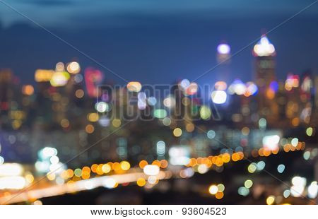 Blur city skyline bokeh background during twilight