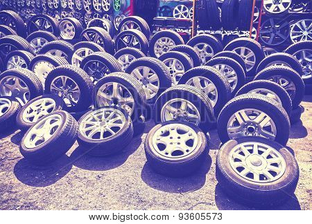 Vintage Style Picture Of Car Wheels And Aluminum Rims.