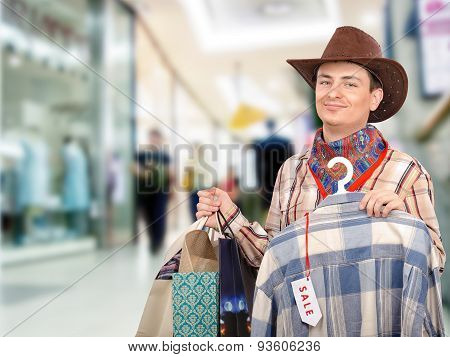 Happy young cowboy shopping