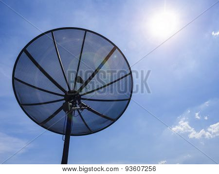 Satellite Dish On Blue Sky Background With Sunlight
