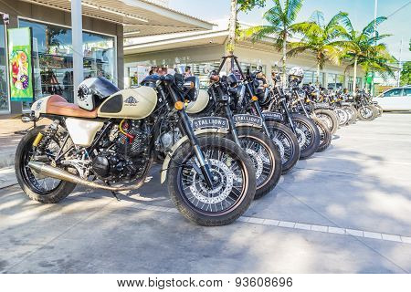 Vintage Motorcycles Parked In The Parking Lot