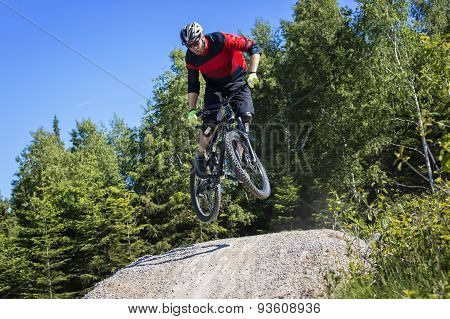 Mountain Bike Rider Jumping Kicker