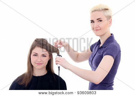 Female Hairdresser Doing Haircut To Young Beautiful Woman Isolated On White