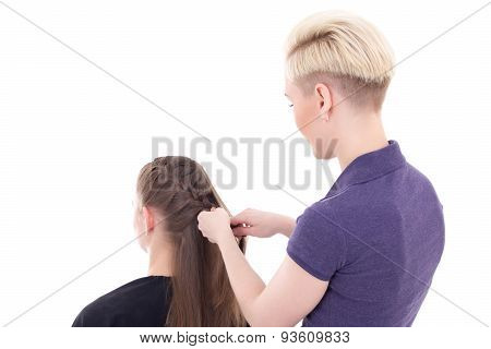 Back View Of Hairdresser Doing Haircut To Young Woman Isolated On White