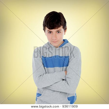 Lad of thirteen on a yellow background