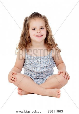 Cute little girl with three year old sitting on the floor isolated on a white background