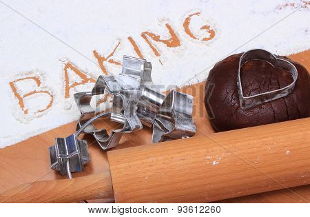 Word Baking Written In Flour And Dough For Gingerbread