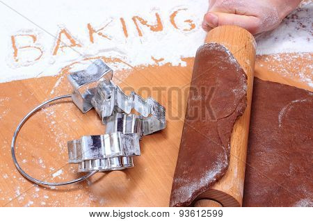 Hand With Rolling Pin Kneading Dough For Gingerbread