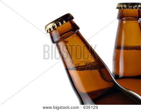Upper Part Of Two Beer Bottles