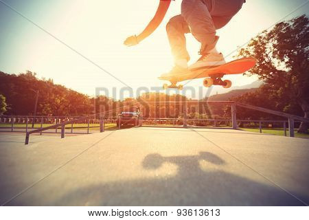 skateboarder legs riding skateboard at skatepark,vintage effect