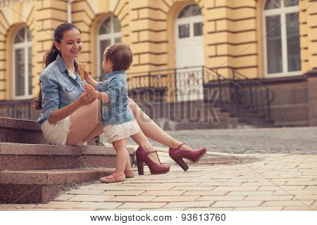 Girl And Mother Have Fun With Ice Cream On Street