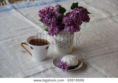 Lilac Bouquet In An Openwork Vase And Tea With A Zephyr