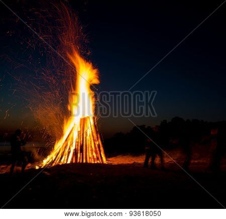 People Resting Near Big Bonfire Outdoor