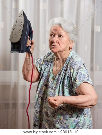 Angry Old Woman With An Iron