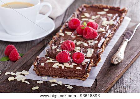 Vegan chocolate tart with almonds
