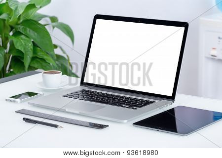 Modern Office Workspace With Laptop Computer Tablet Pc And Smartphone On The Desk