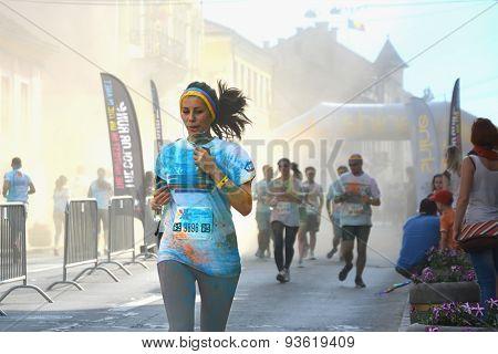 Young Girl Running Through The Shine Powder Cloud
