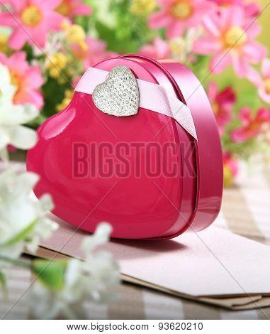 heart shaped gift box on flower background