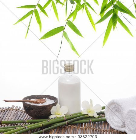 White orchid with salt in wooden bowl ,grove, oil,towel on mat