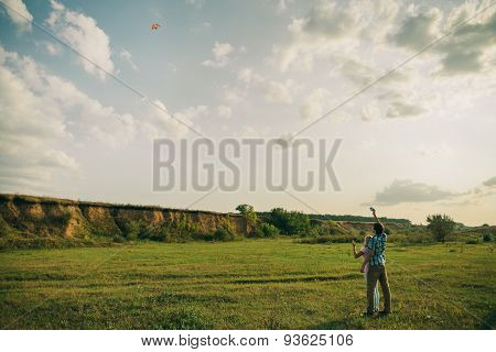 Lovely Couple Play With Air Kite At Green Meadow