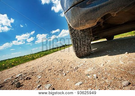 Car tires on gravel goad