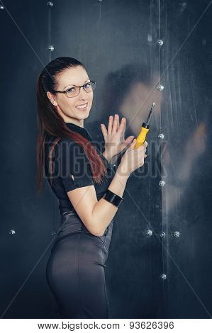 businesswoman with screwdriver