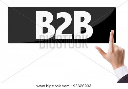 Businessman pressing button with the text: B2B
