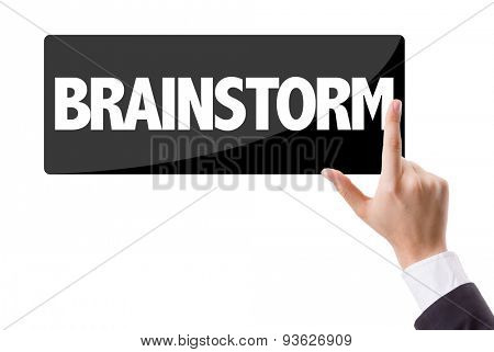 Businessman pressing button with the text: Brainstorm