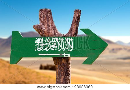 Saudi Arabia flag wooden sign with desert road background