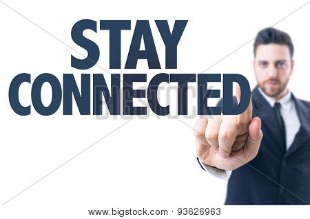 Business man pointing the text: Stay Connected